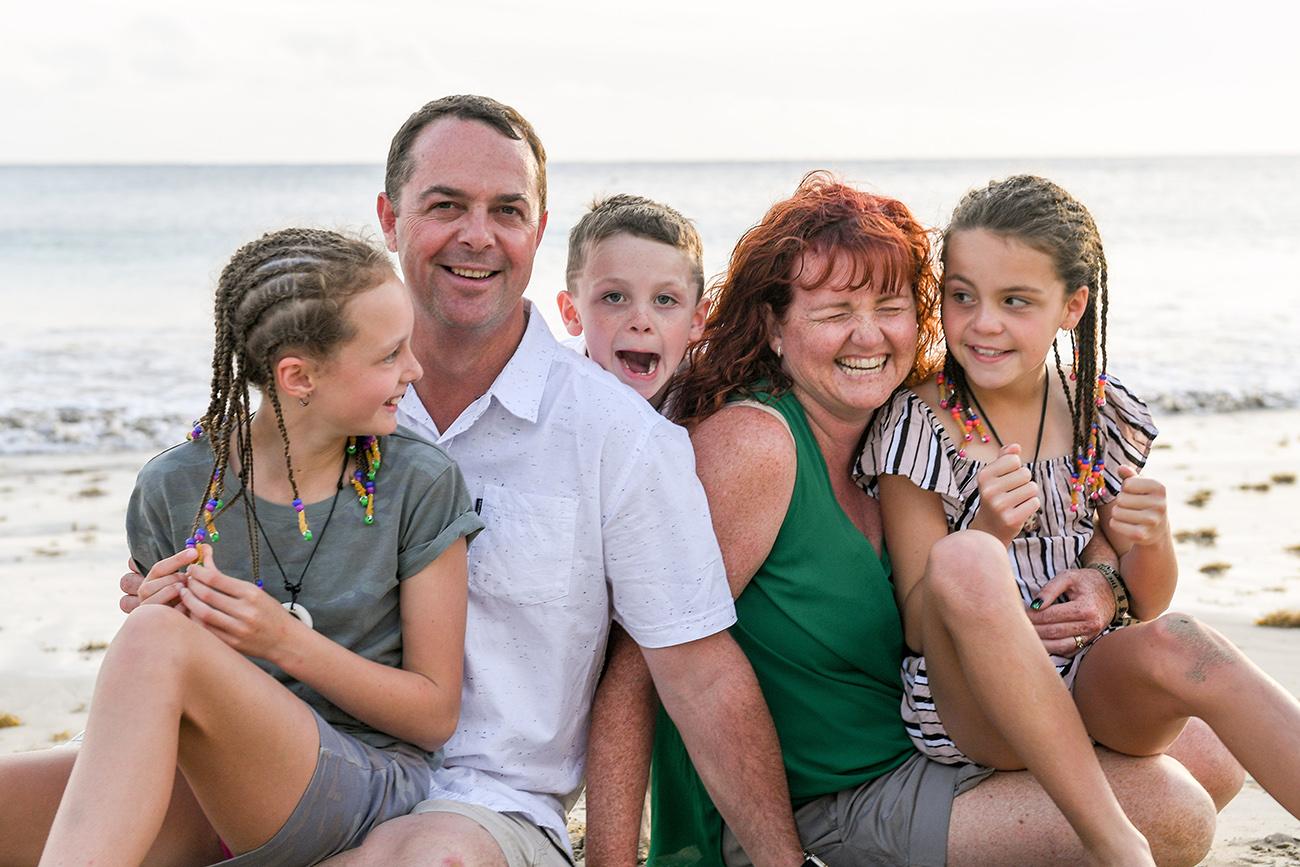 Cute family smiles at family beach photography Fiji