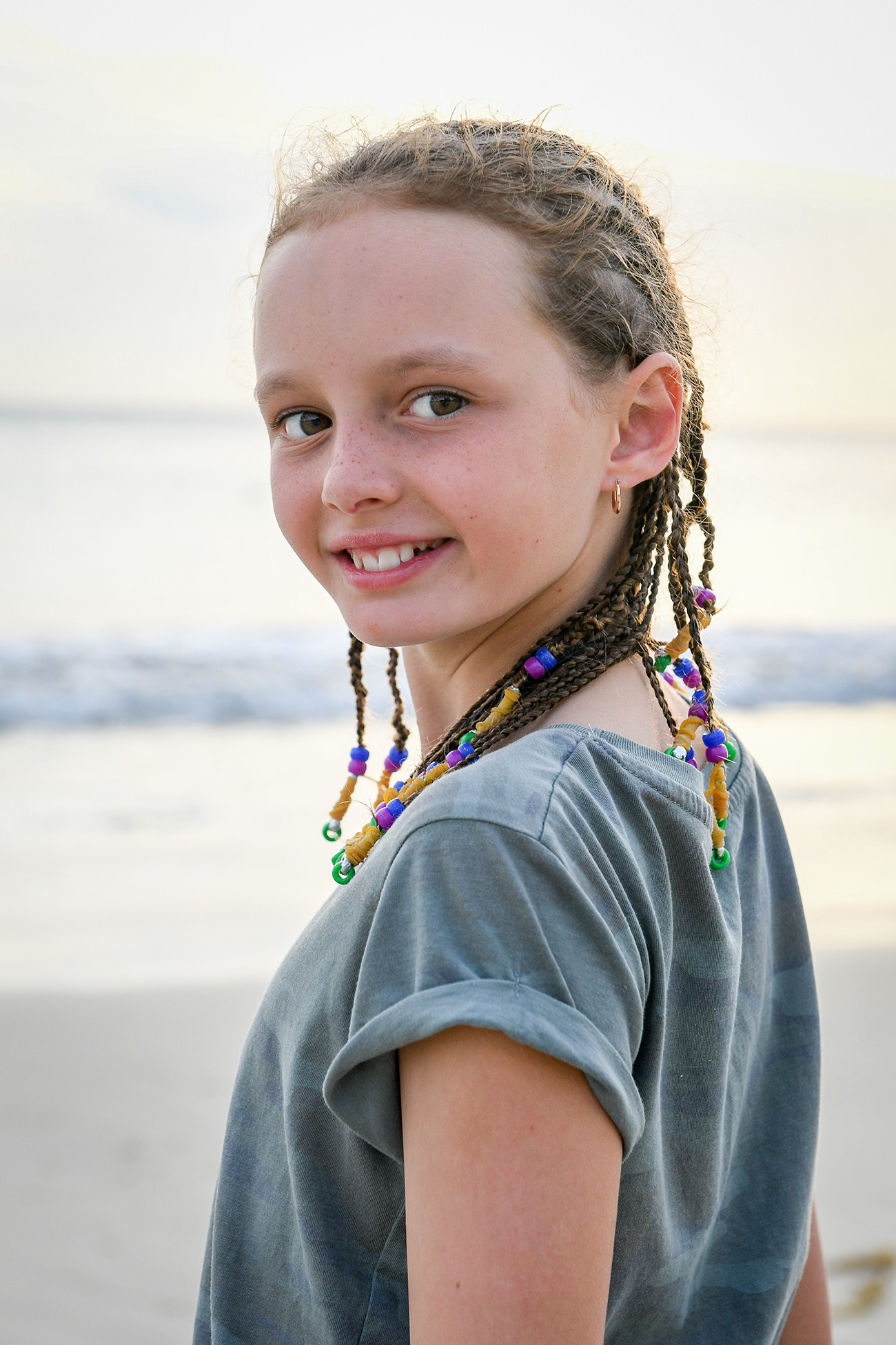 Cute young girl smiles back at the camera in Fiji photoshoot