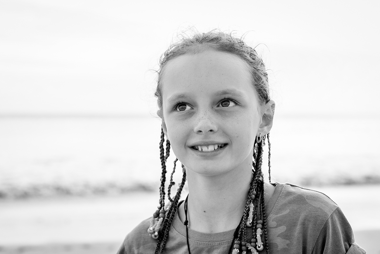 Black and white picture of caucasian girl in braids