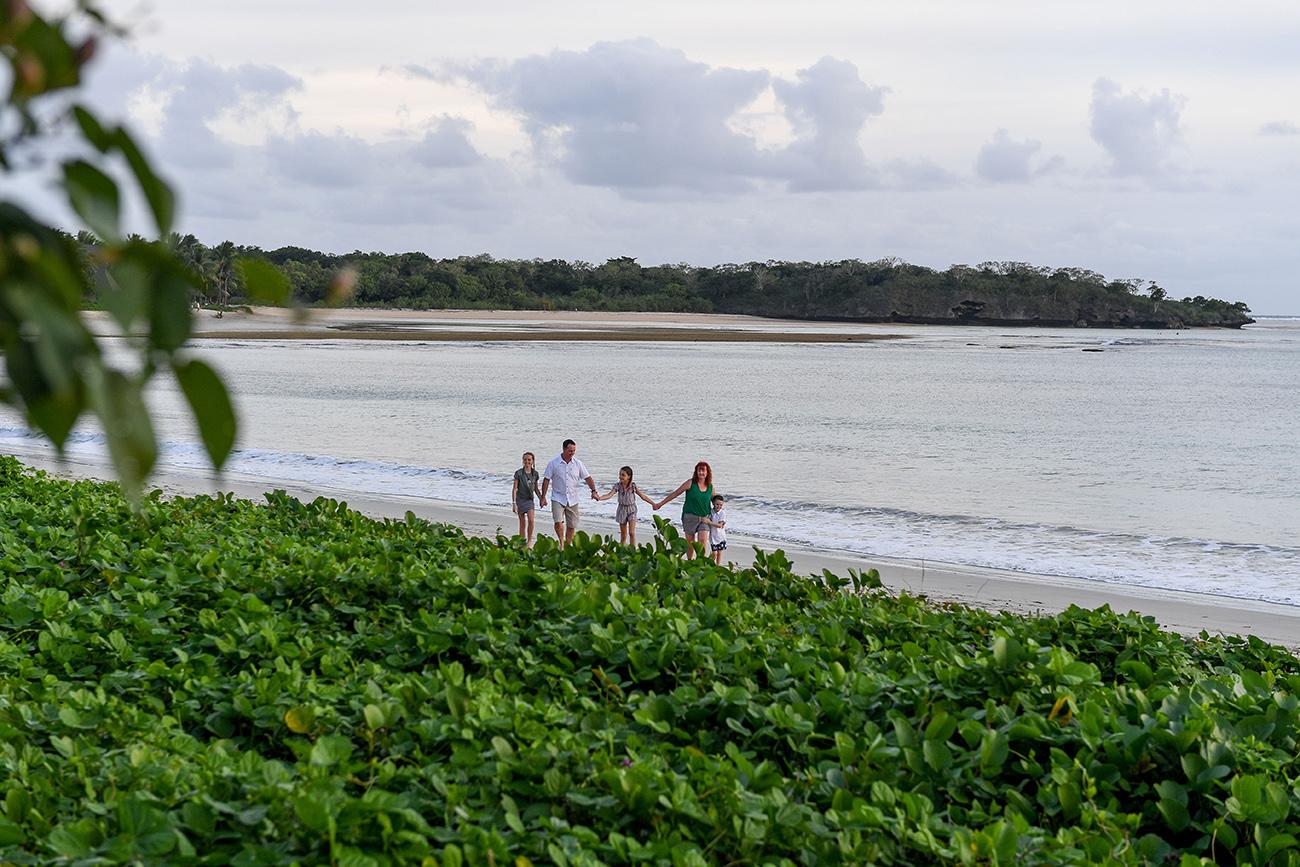 Wideshot of family walking on the beach in Fiji photoshoot
