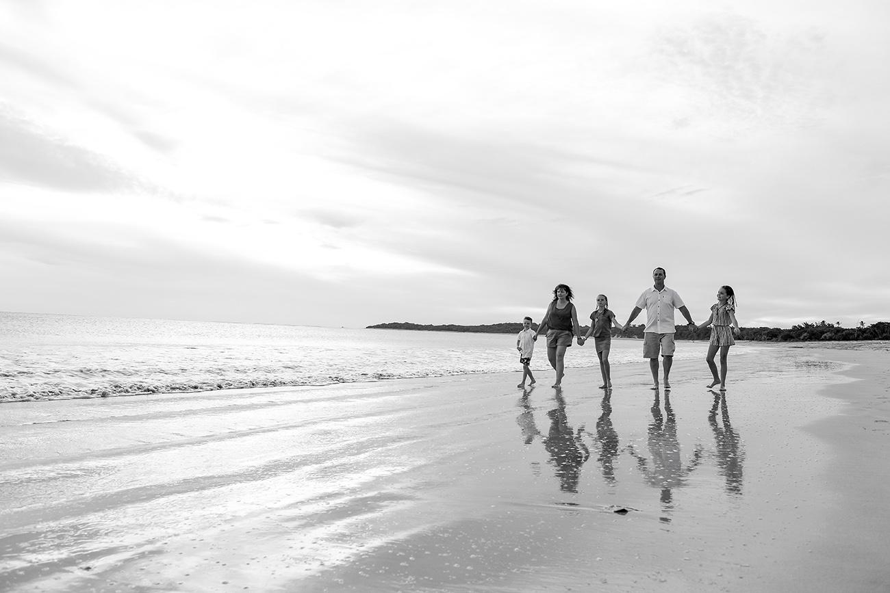 Black and white photo of family walking on the beach in Natadola Fiji