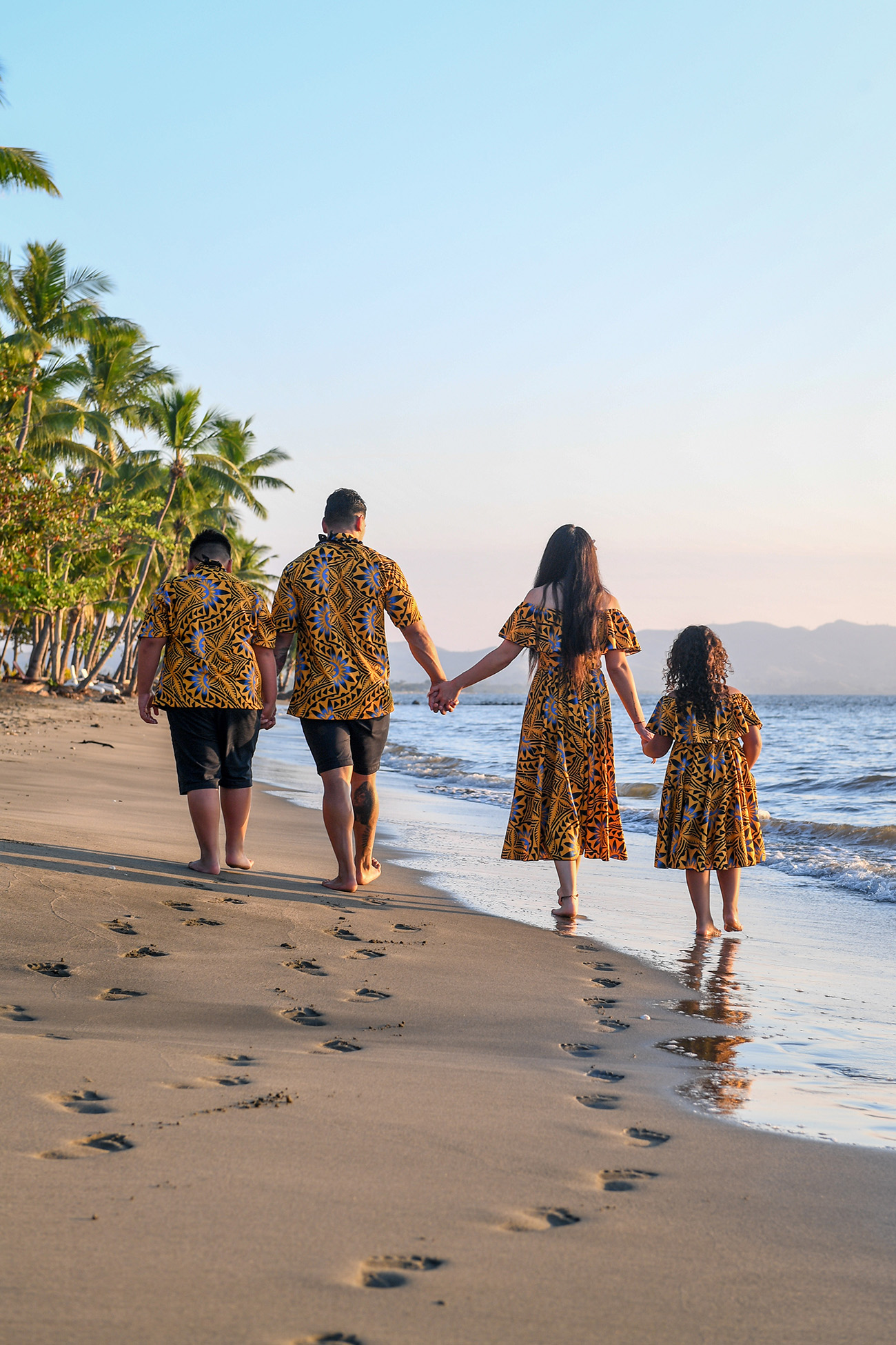The family strolls into the ocean at Double Tree Hilton