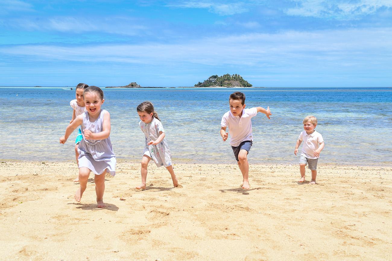 The grandchildren take off on the yellow sand beaches at Malolo Island Resort