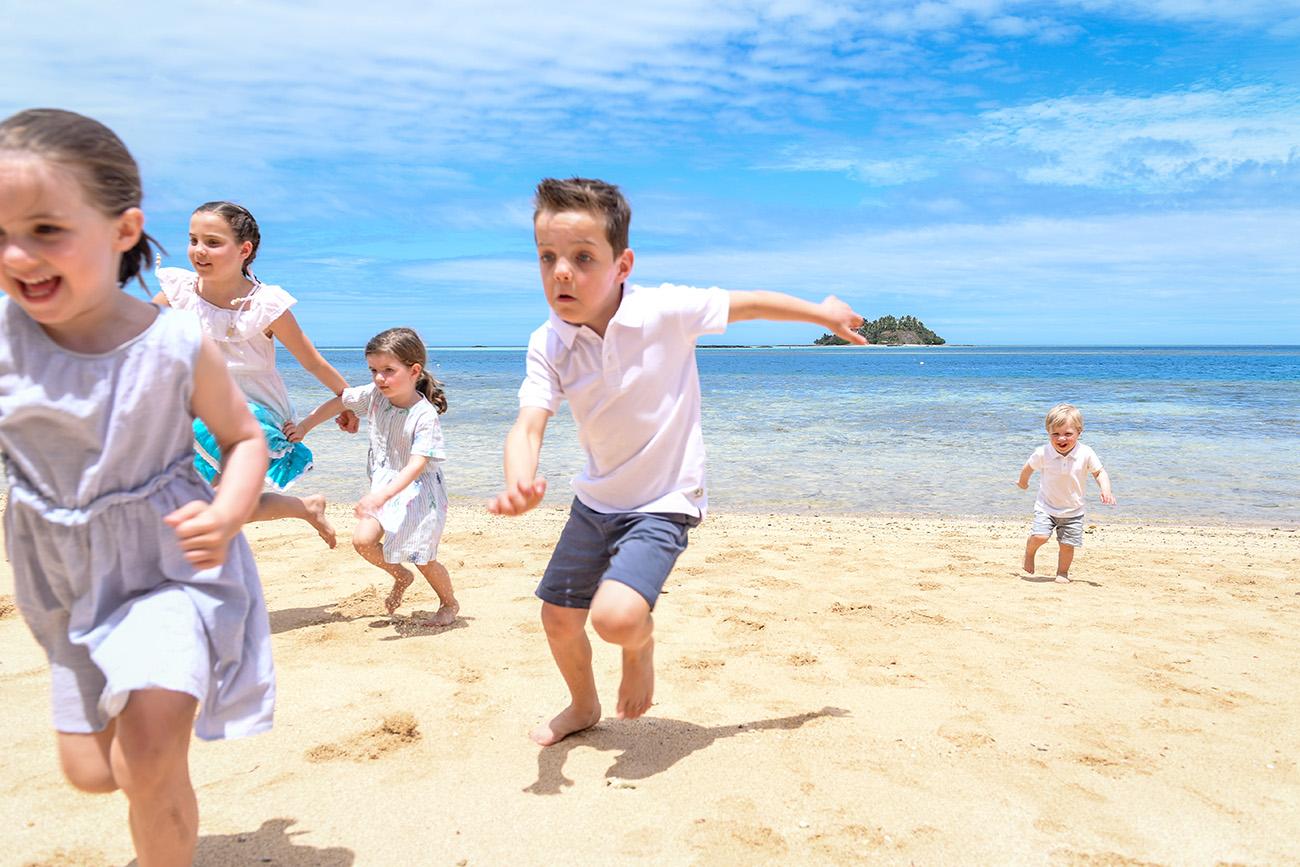 The grandchildren race on the yellow sand beaches at Malolo Island Resort
