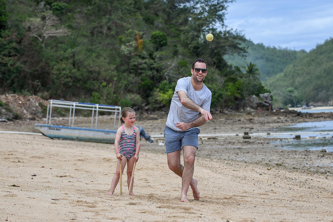 The dad throws a family cricket ball