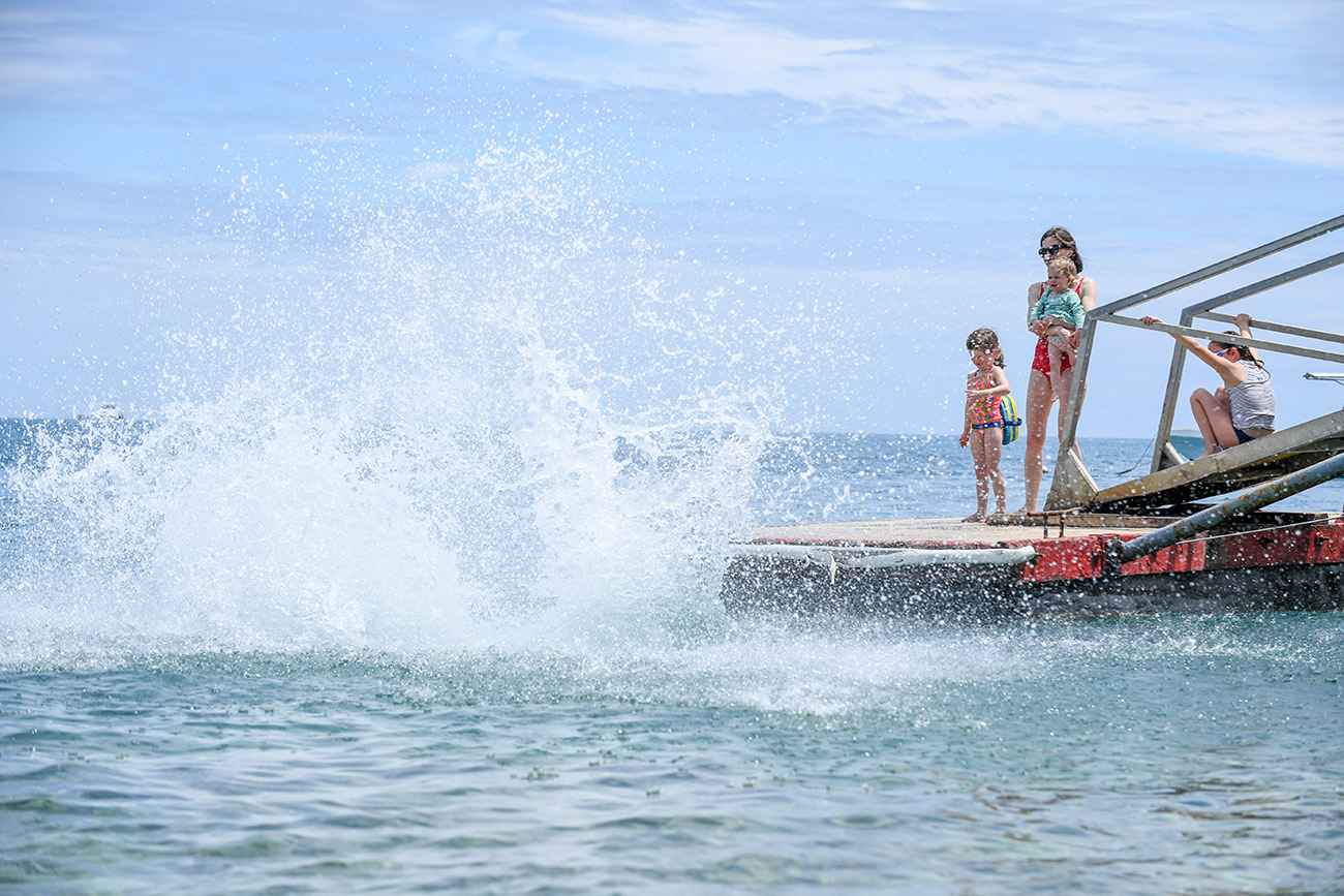 The family lands into the water with a big splash