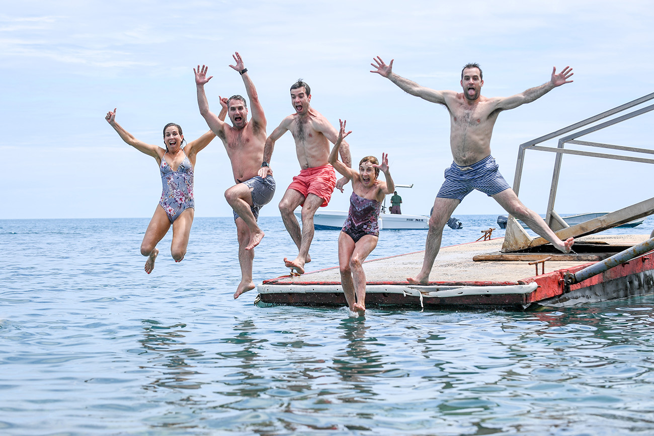 The entire family leaps from the dock to make a gigantic water bomb