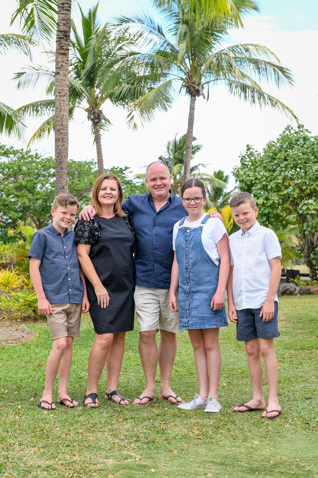 A cute caucasian family pose for a photo in Denarau Fiji