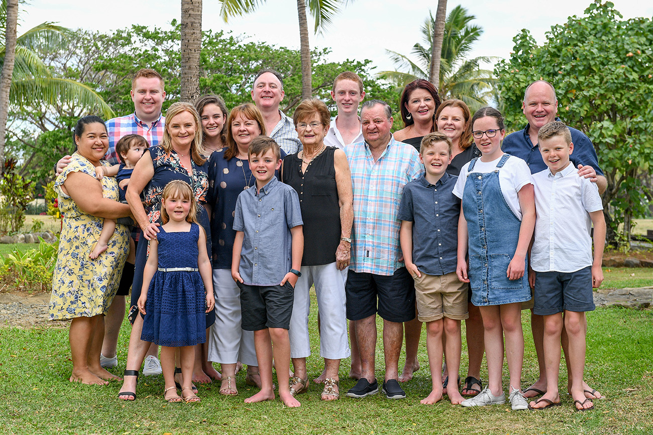 Three generations of a caucasian family posing for a photo in Denerau Fiji