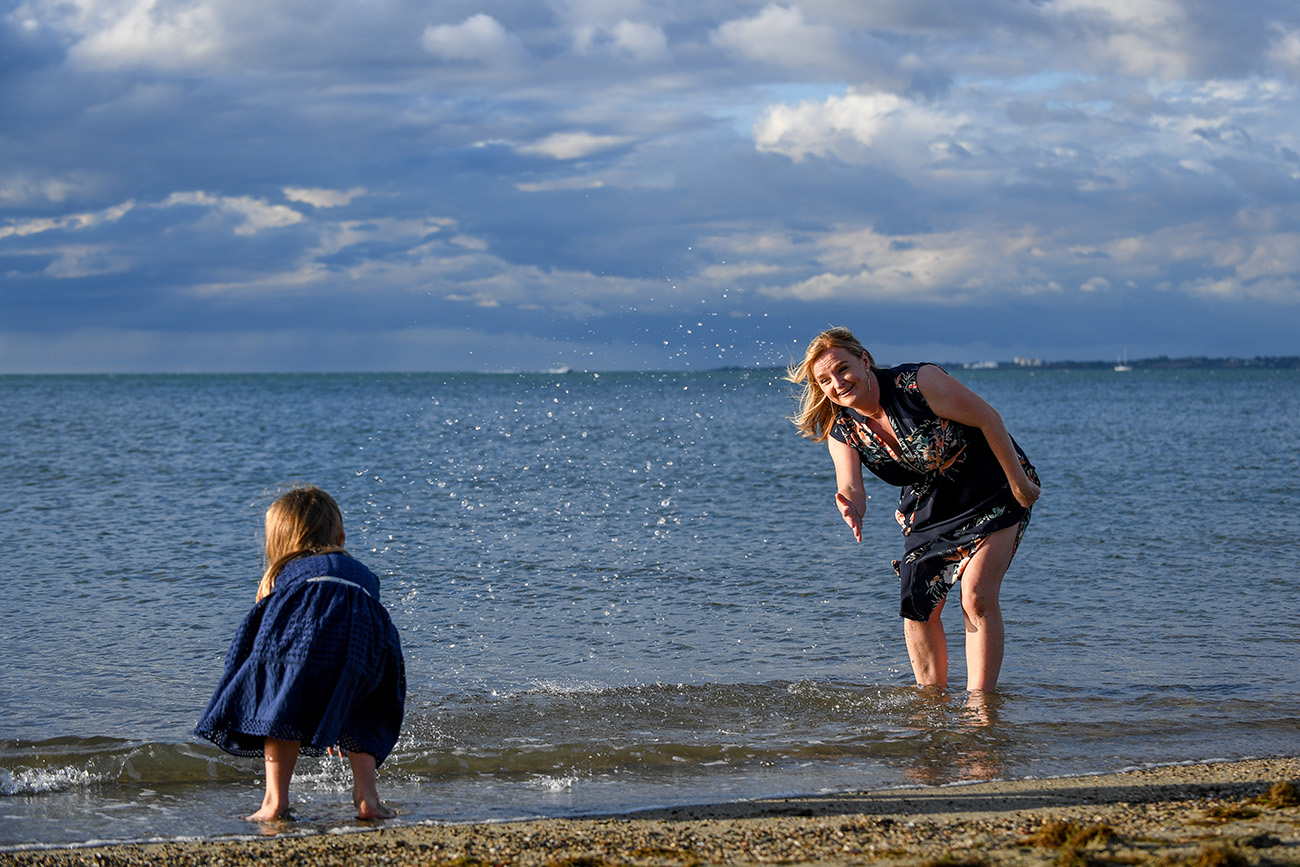 Mother plays with her daughter on the shores of Denerau Fiji