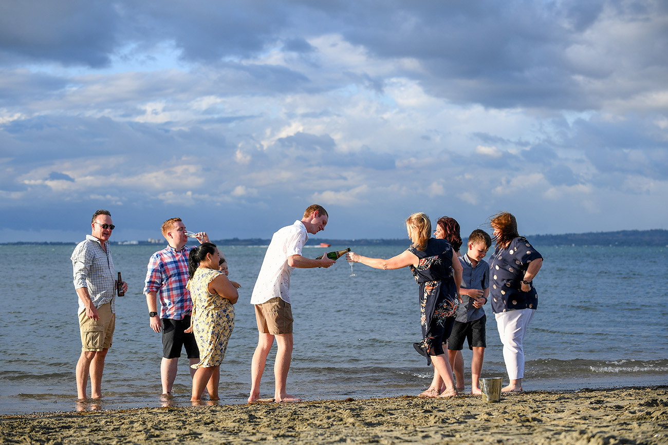 The family stands on the shores of the waters of the Denarau Fiji