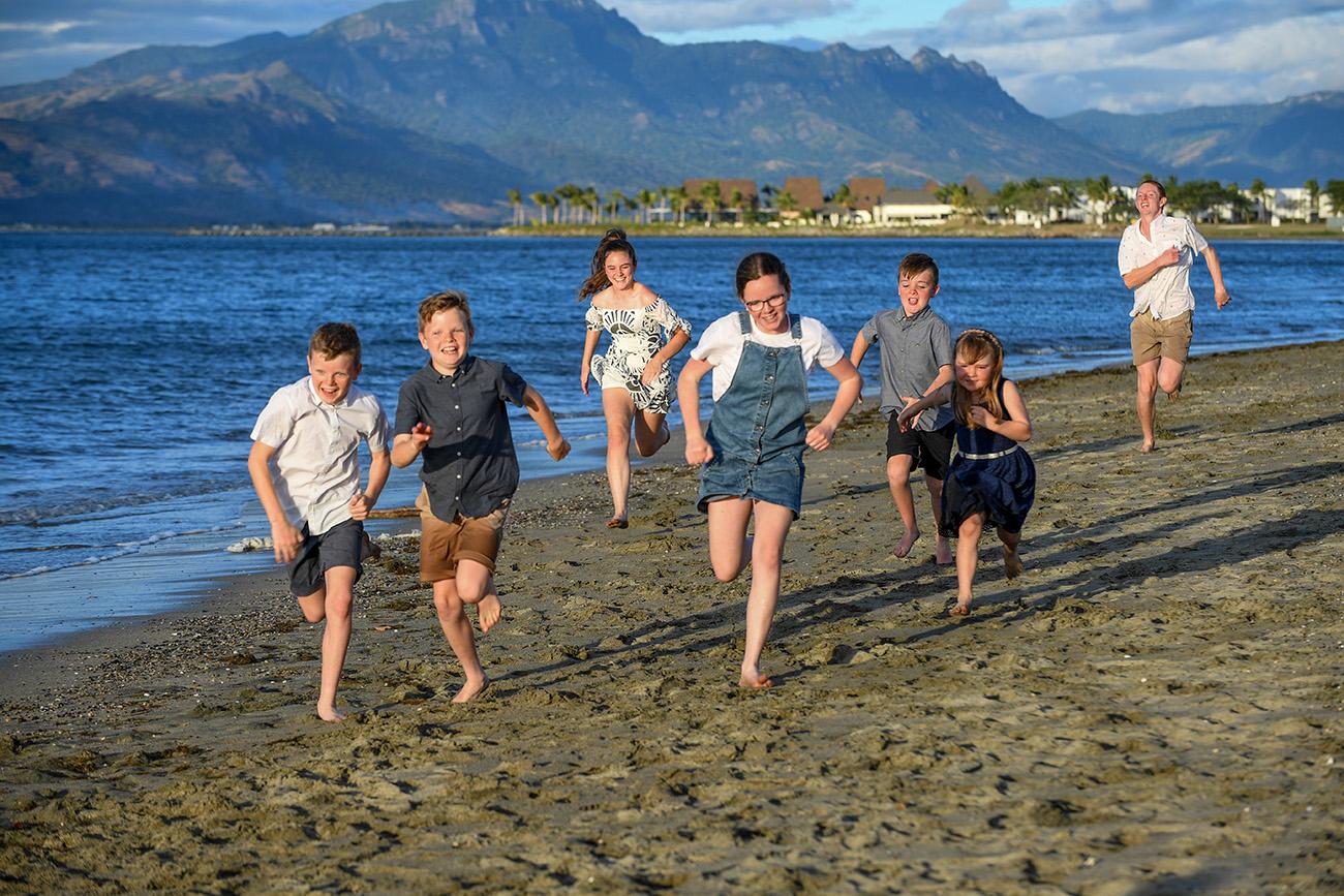 Cousins run on the beach at Denarau Fiji