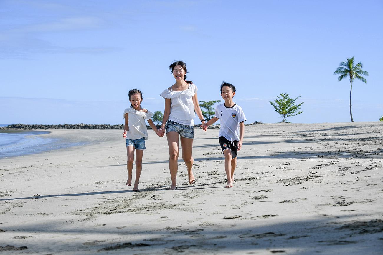 Cute asian family on the beach at Natadola Fiji