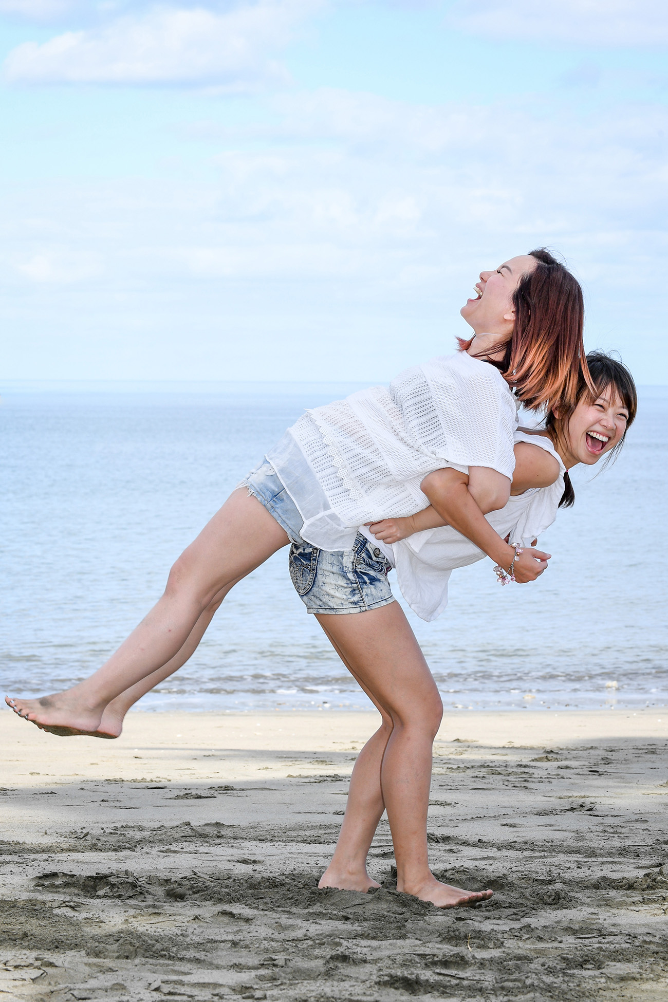 Two sisters playing on the beach