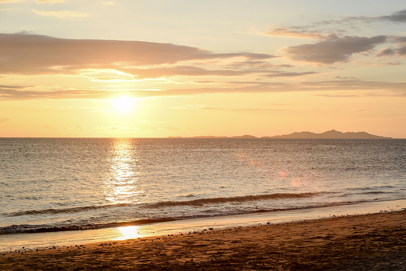A golden Fiji sunset over the Pacific ocean
