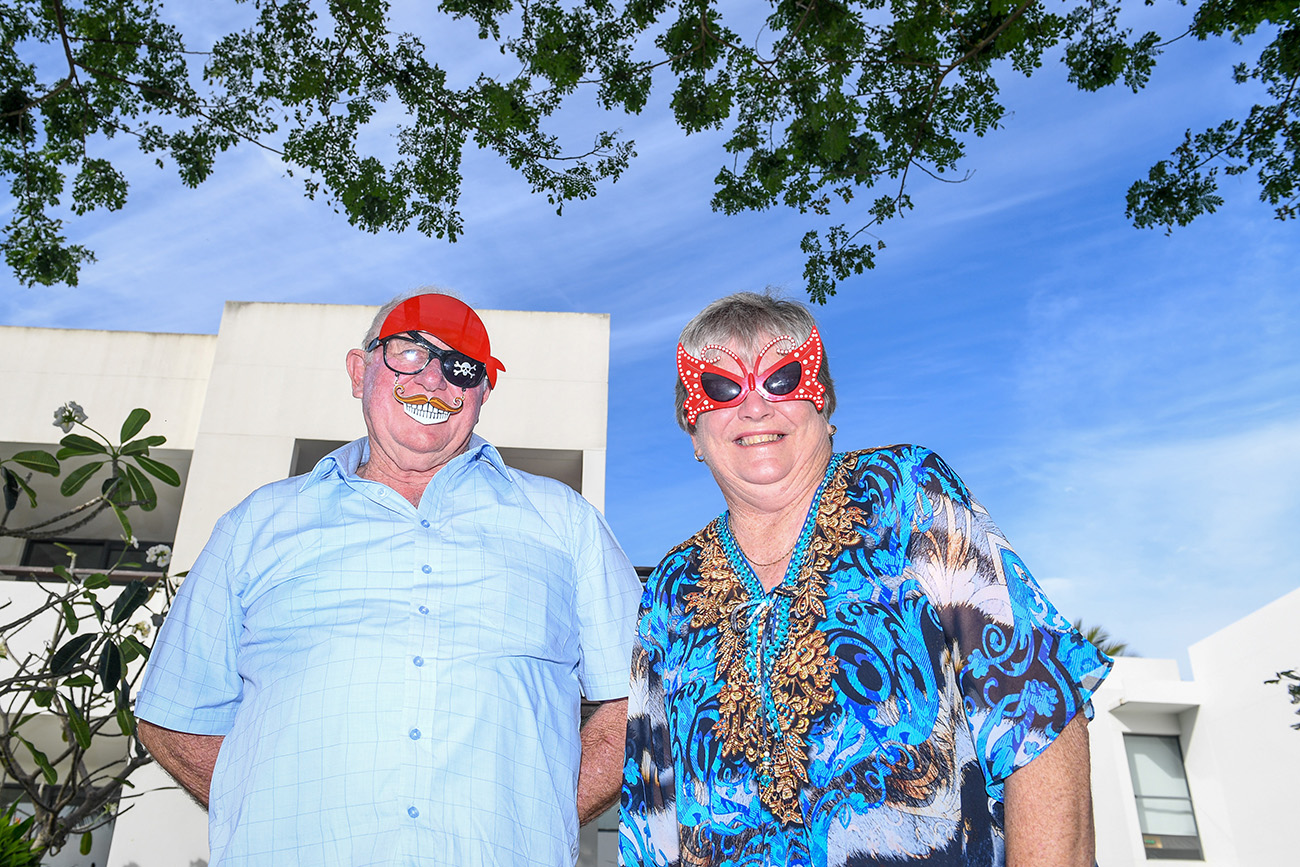 Goofy grandparents where a pirate patch and butterfly mask