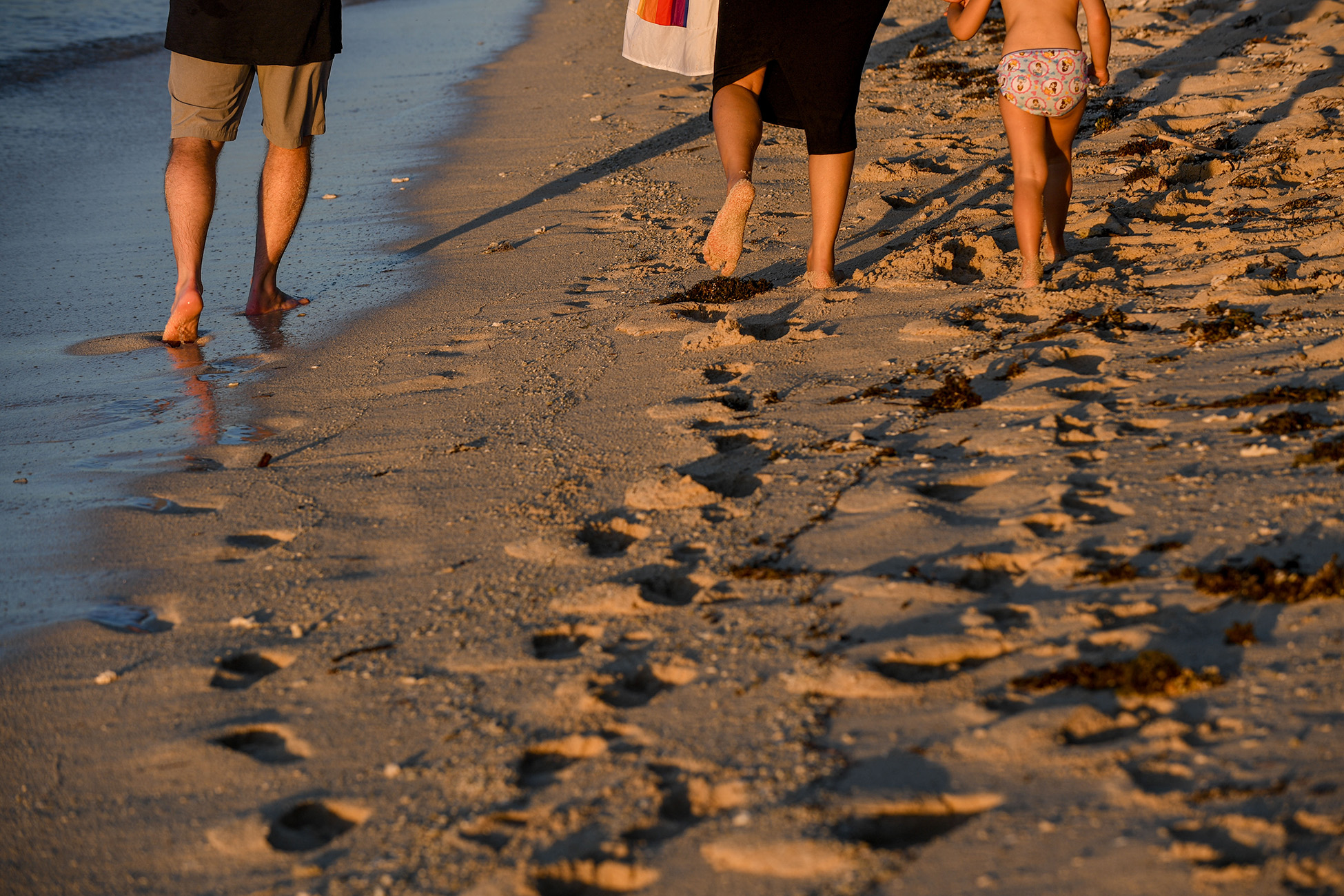 The family leaves footprints in the sand