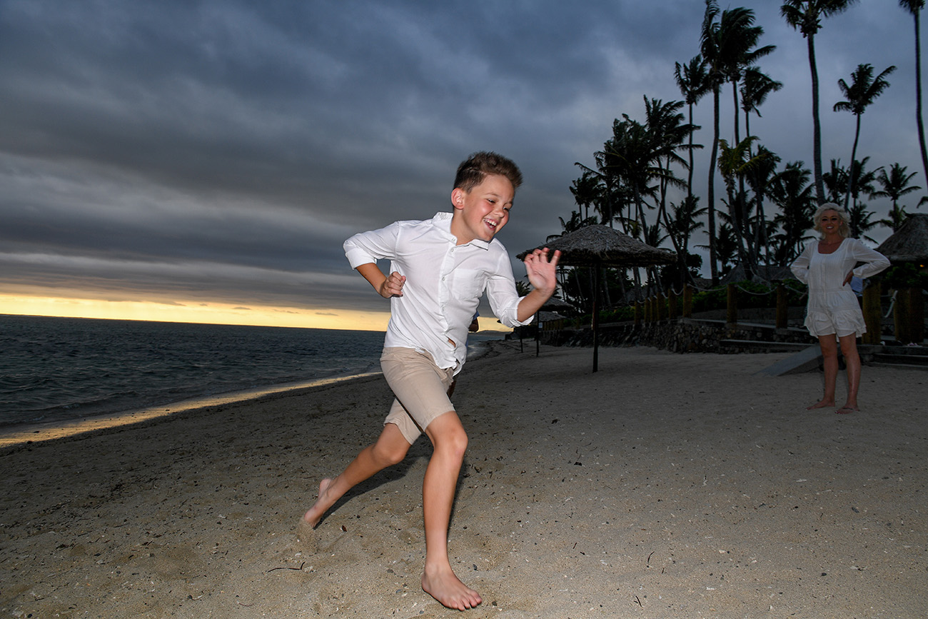 Children racing at the beach in Fiji for the family photoshoot