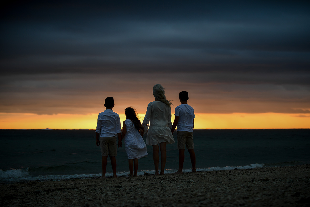 Silhouette of the family starring at the beach