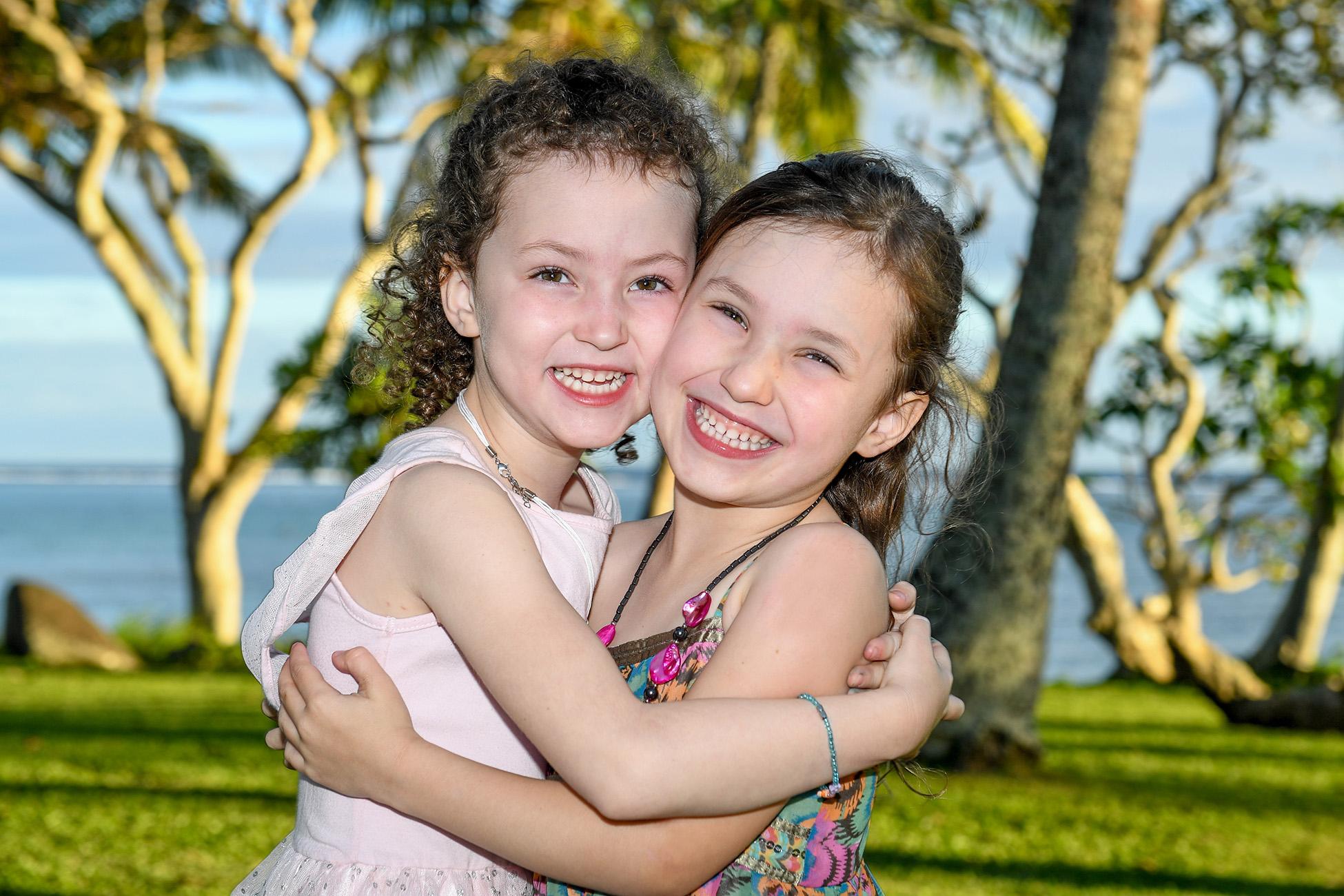 Portrait of sisters hugging in Fiji