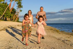 Family racing on the beach