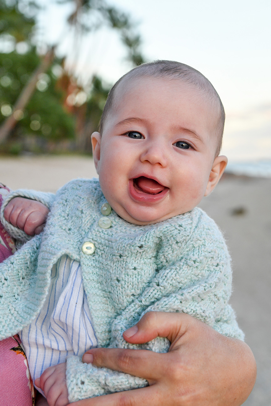 portrait of a baby laughing on the beach