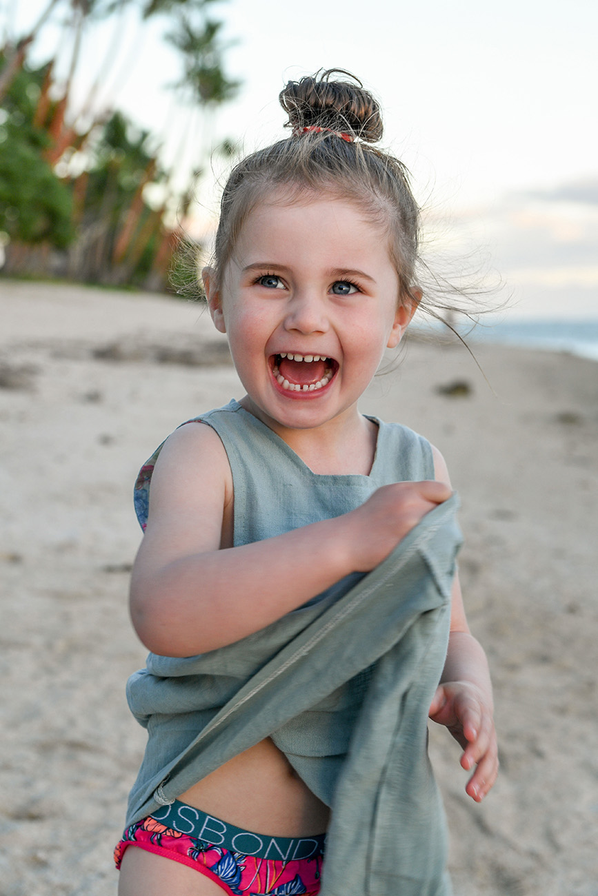 candid portrait of a cute girl laughing