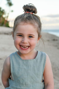 candid portrait of a girl smiling at sunset in Fiji