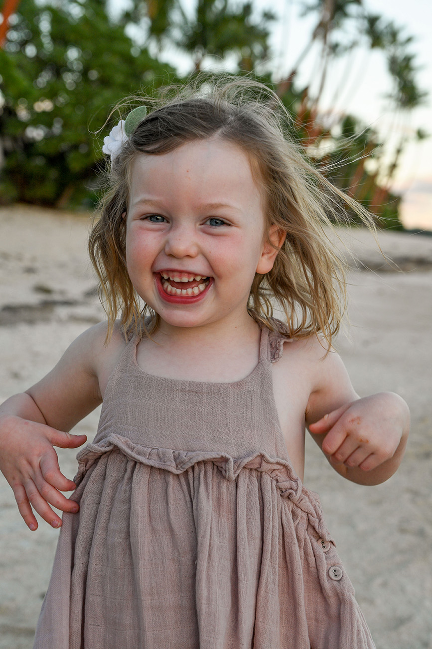 Portrait of a young girl smiling on the beach in Fiji